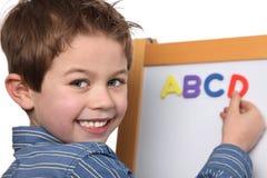 Muchacho joven que aprende el ABC Fotos de archivo