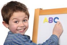Muchacho joven que aprende el ABC Foto de archivo libre de regalías