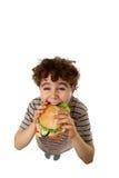 Muchacho joven que come el emparedado sano Imagen de archivo
