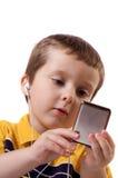 Muchacho que escucha la música Foto de archivo libre de regalías