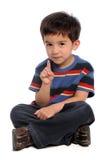 Muchacho joven que gesticula el número uno Imagen de archivo
