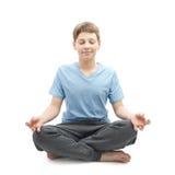 Muchacho joven que hace yoga Fotografía de archivo libre de regalías