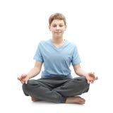 Muchacho joven que hace yoga Imagen de archivo libre de regalías