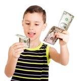 Muchacho joven que juega feliz con los dólares Imagen de archivo