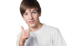 Muchacho joven que muestra muy bien imagen de archivo libre de regalías