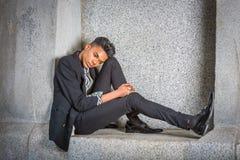 Muchacho joven que piensa afuera Fotografía de archivo libre de regalías