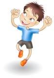 Muchacho joven que salta para la alegría Imágenes de archivo libres de regalías