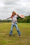 Muchacho joven que salta para la alegría II Imagen de archivo libre de regalías