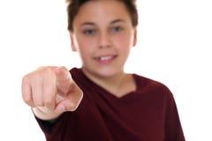 Muchacho joven que señala con su finger le quiero Foto de archivo libre de regalías