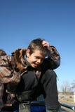 Muchacho joven que se sienta en un carro Foto de archivo libre de regalías