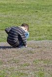Muchacho joven tímido Fotos de archivo