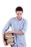 Muchacho joven y hermoso, con los libros en las manos Fotografía de archivo libre de regalías