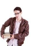 Muchacho joven y hermoso, con los libros en las manos Imágenes de archivo libres de regalías
