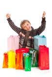 Muchacho jovial con los bolsos de compras Imágenes de archivo libres de regalías