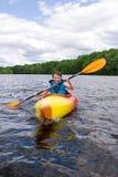 Muchacho kayaking Fotos de archivo libres de regalías