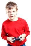 Muchacho lindo con el gamepad en manos Fotografía de archivo libre de regalías