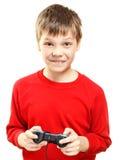 Muchacho lindo con el gamepad en manos Imagenes de archivo