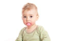 Muchacho lindo con el maniquí de un bebé Imagenes de archivo
