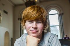 Muchacho lindo con el pelo rojo Fotografía de archivo