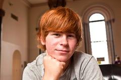 Muchacho lindo con el pelo rojo Fotografía de archivo libre de regalías