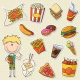 Muchacho lindo con Junk Food Foto de archivo