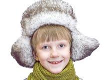 Muchacho lindo de risa en casquillo del invierno Fotografía de archivo
