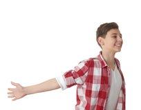 Muchacho lindo del adolescente sobre el fondo blanco Imagen de archivo