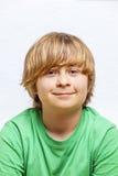 Muchacho lindo en camisa verde Fotografía de archivo libre de regalías