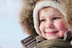 Muchacho lindo en snowsuit Imágenes de archivo libres de regalías