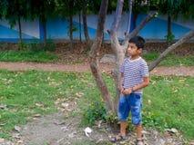 Muchacho lindo en un parque Imágenes de archivo libres de regalías