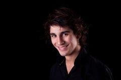 Muchacho lindo, sonriendo en negro Foto de archivo