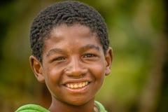 Muchacho malgache feliz Imagenes de archivo