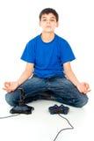 Muchacho meditating cerca de la palanca de mando fotos de archivo