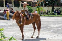 Muchacho mexicano a caballo Imágenes de archivo libres de regalías