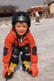 Muchacho patinador en el hielo Foto de archivo libre de regalías
