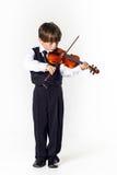 Muchacho pelirrojo del preescolar con el violín Imagen de archivo libre de regalías