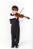 Muchacho pelirrojo del preescolar con el violín Imagenes de archivo