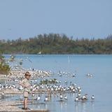 Muchacho por el lago Imagen de archivo libre de regalías