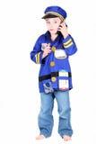 Muchacho preescolar joven en traje de la policía Foto de archivo libre de regalías