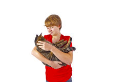 Muchacho que abraza con su gato Fotos de archivo libres de regalías