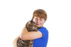 Muchacho que abraza con su gato Fotografía de archivo