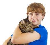 Muchacho que abraza su gato Imagen de archivo