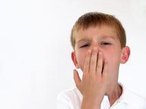 Muchacho que bosteza Foto de archivo libre de regalías