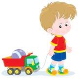Muchacho que camina con los juguetes libre illustration