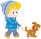 Muchacho que camina con su perro ilustración del vector
