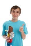 Muchacho que come el conejo del chocolate Imagen de archivo libre de regalías