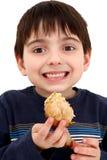 Muchacho que come el pollo Foto de archivo