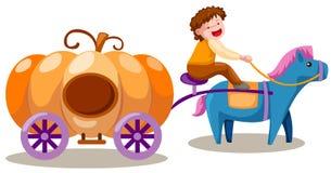 Muchacho que conduce el carro de la calabaza Imagen de archivo libre de regalías