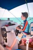Muchacho que conduce el catamarán Foto de archivo