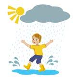 Muchacho que corre en los charcos de la lluvia Fotografía de archivo libre de regalías